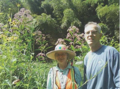 Mary and Bill in front of orchids umbels.