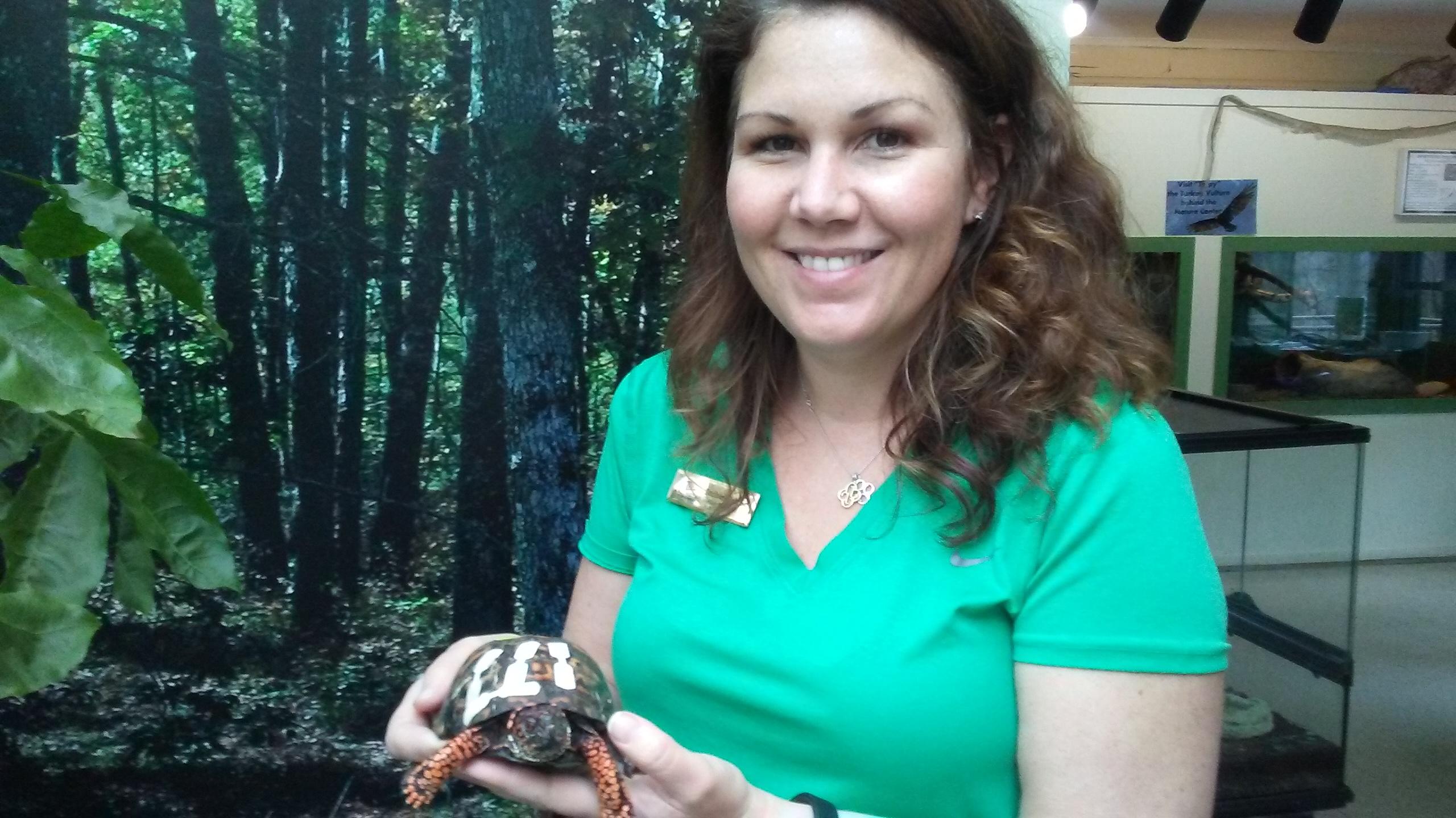 Photo of Rachel Tolman (Long Branch Park Naturalist) holding turtle, by Lisa Stern