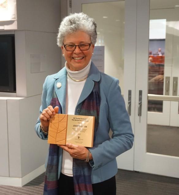 Phot of ARMN member Joanne Hutton holding the 2017 Bill THomas Award