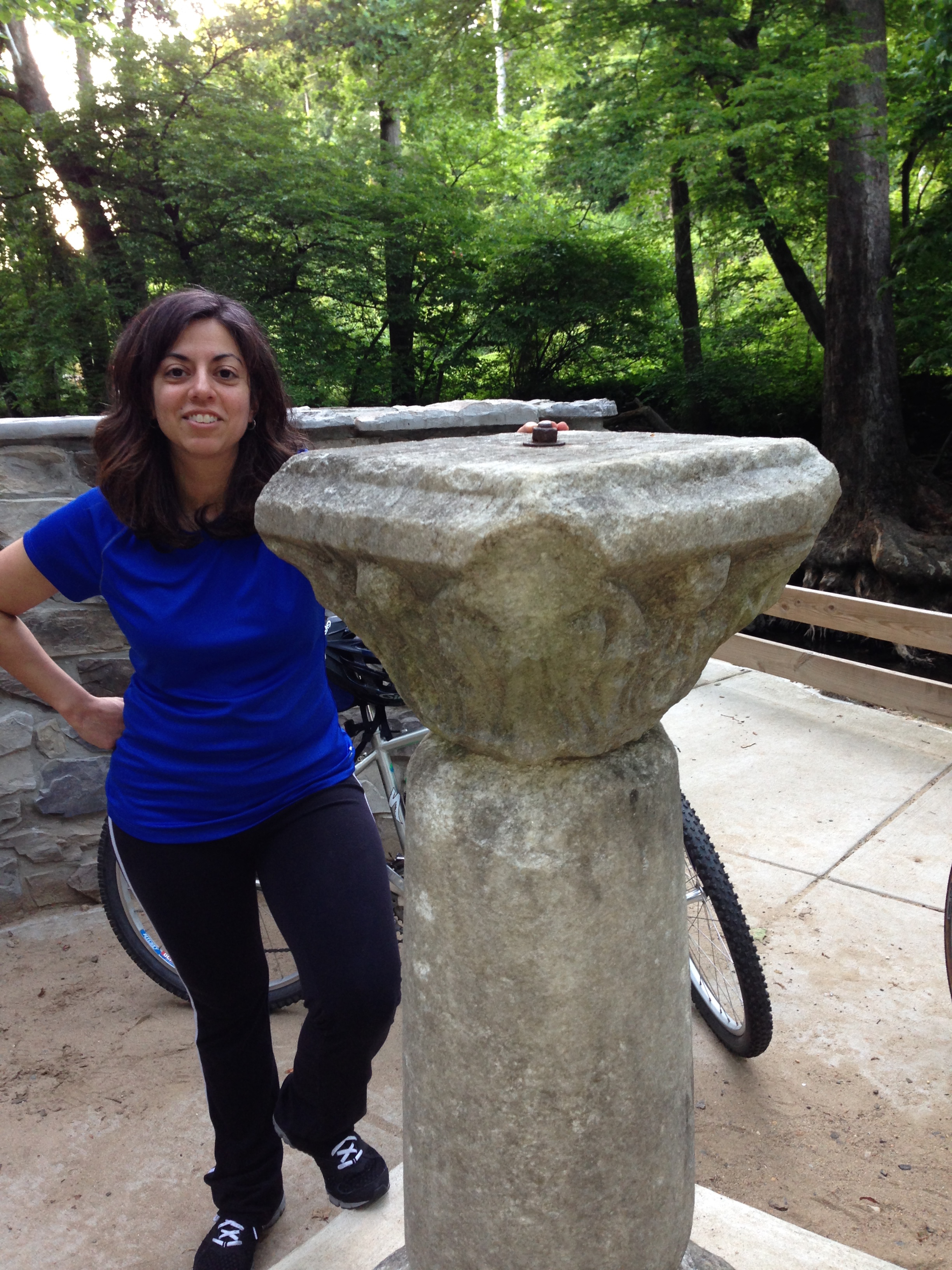 Photo of ARMN member Yolanda Villacampa next to the George Washington Survey Marker Monument.