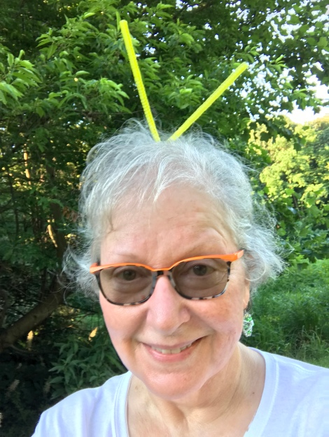 "ARMN volunteer wears ""firefly antennae"" made from bright yellow pipe cleaners"