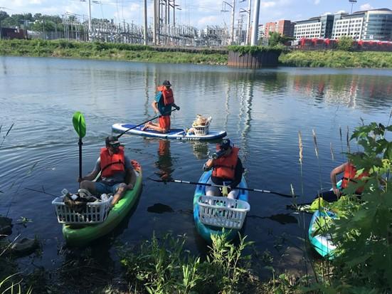 Photo of volunteers on kayaks in four mile run creek