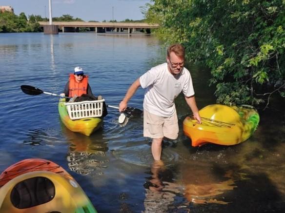Photo of volunteers in kayaks on the creek